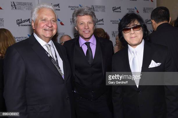 Sony Music CEO Martin Bandier Jon Bon Jovi and Executive Vice President of Creative Services for ASCAP John Titta pose backstage at the Songwriters...