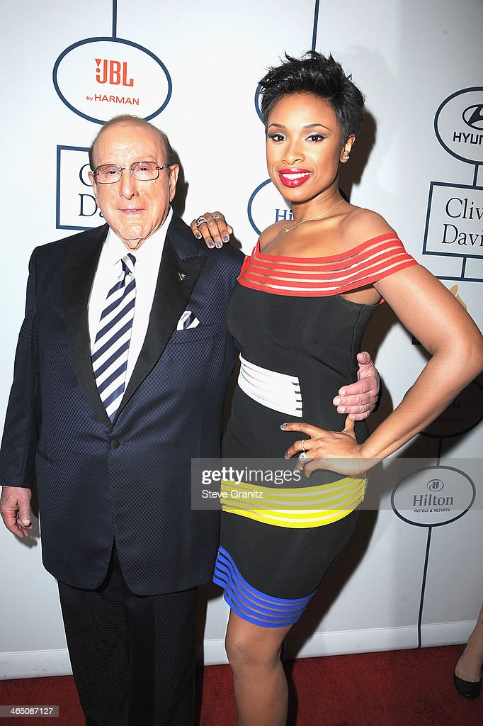 Sony Music Chief Creative Officer Clive Davis (L) and recording artist Jennifer Hudson attend the 56th annual GRAMMY Awards Pre-GRAMMY Gala and Salute to Industry Icons honoring Lucian Grainge at The Beverly Hilton on January 25, 2014 in Los Angeles, California.