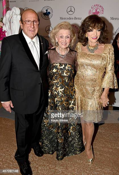 Sony Music Entertainment Chief Creative Officer Clive Davis Carousel of Hope Chairman Barbara Davis and actress Joan Collins attend the 2014 Carousel...