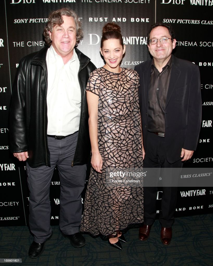 Sony Pictures Classics Co-President Tom Bernard, actress Marion Cotillard and and Sony Pictures Classics Co-President Michael Barker attend The Cinema Society with Dior & Vanity Fair host a screening of 'Rust and Bone' at Landmark Sunshine Cinema on November 8, 2012 in New York City.