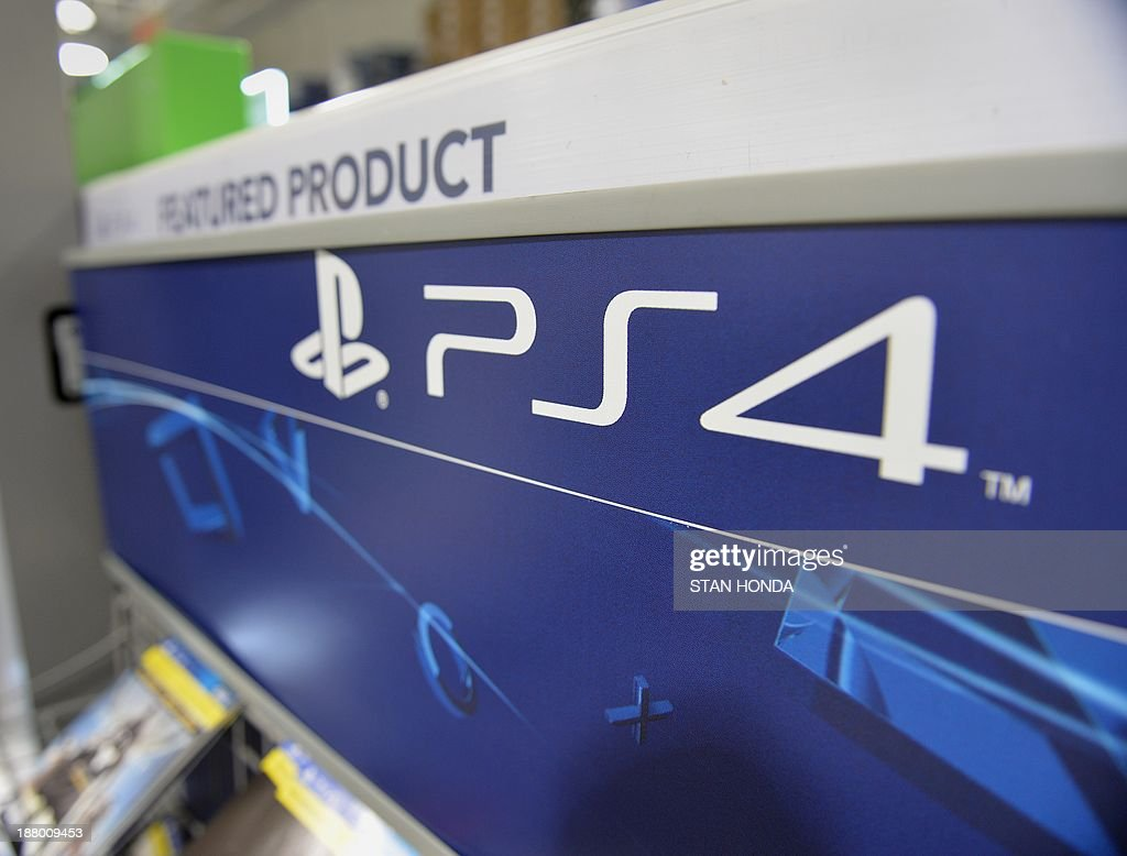 A Sony PlayStation 4 console display in a Best Buy store on the upper East Side of Manhattan November 14, 2013 in New York. The PlayStation 4 is set to launch at 00:01 EST November 15. AFP PHOTO/Stan HONDA