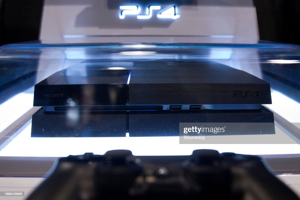 A Sony PlayStation 4 console stands on display at a Game Stop store during the Sony PlayStation 4 midnight launch event in San Francisco, California, U.S., on Thursday, Nov. 14, 2013. Sony Corp., poised to release the PlayStation 4 game console this week, is confident it can meet analysts' sales estimates of 3 million units by year-end, exploiting an early advantage over Microsoft Corp.'s Xbox One. Photographer: Erin Lubin/Bloomberg via Getty Images