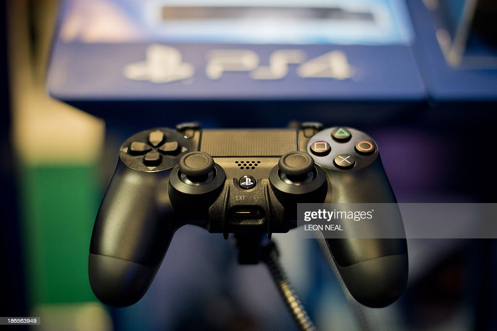 A Sony Playstation 4 controller is pictured at the Gadget Show Live@Christmas at Earl's Court in London, on November 1, 2013. Exhbitiors gather to show off their latest products in time for the Christmas season with this years stands focusing heavily on radio-controlled vehicles and audio equipment. AFP PHOTO/Leon Neal