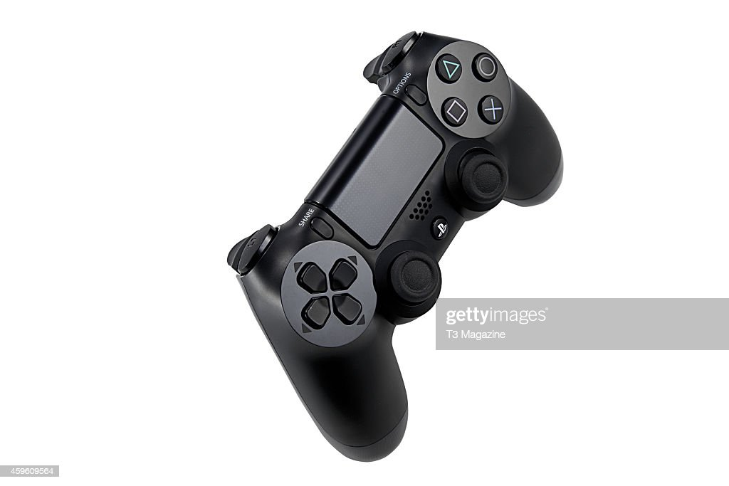 A Sony PlayStation DualShock 4 controller photographed on a white background taken on November 12 2013