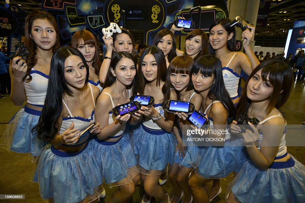 Sony Playstation promotional girls pose for a picture during the Asia Game Show (AGS) in Hong Kong on December 21, 2012. The AGS is highlighting products from the electronic gaming industry and runs from December 21 to 24. AFP PHOTO / Antony DICKSON