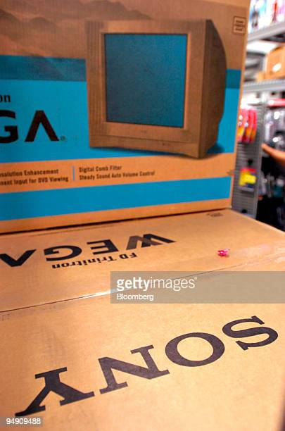 Sony televisions sit in the stock room of a Best Buy store in New York on June 14 2004 The US trade deficit unexpectedly widened in April to an...