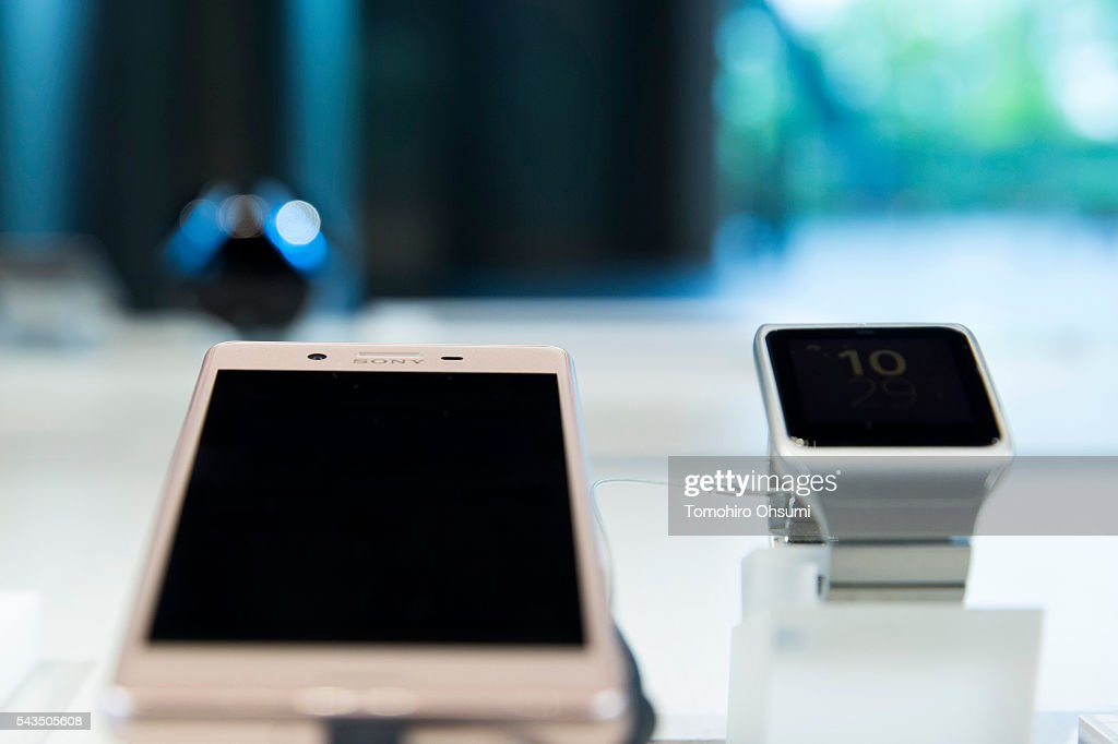 A Sony Xperia smartphone, left, is displayed at the Sony Corp. headquarters on June 29, 2016 in Tokyo, Japan. Sony announced its mid-range business strategy plan from FY2015 through 2017 today.