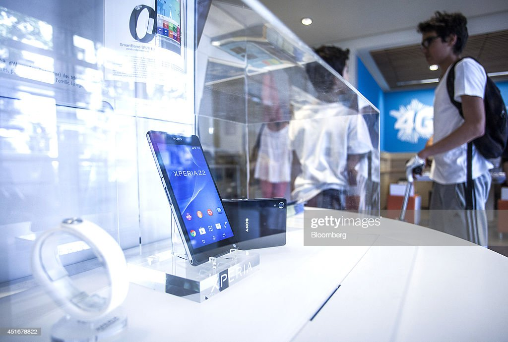 A Sony Xperia Z2 smartphone and compatible devices, manufactured by Sony Corp, are displayed for sale inside a Bouygues Telecom store, operated by Bouygues SA in Paris, France, on Thursday, July 3, 2014. Bouygues Telecom, France's third-largest mobile operator, was looking for a buyer as profitability and cash generation declined. Photographer: Balint Porneczi/Bloomberg via Getty Images