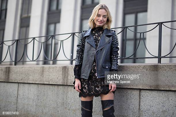 Sonya Esman is seen at Herve Leger by Max Azria wearing Lovett jacket Cameo dress and Schutz boots during New York Fashion Week Women's Fall/Winter...