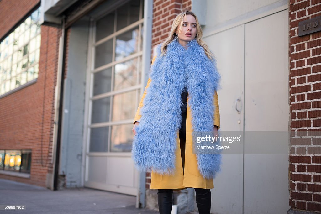 Sonya Esman is seen at Jill Stuart wearing Charlotte Simon blue vest, Cameo Collective yellow coat, Robert Rodriguez pants, and Senso shoes during New York Fashion Week: Women's Fall/Winter 2016 on February 13, 2016 in New York City.