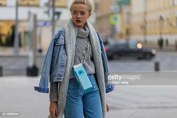 Sonya Styles wearing a denim jacket and jeans and oversized long scarf and turleneck sweater and glasses during MercedesBenz Fashion Week Russia on...