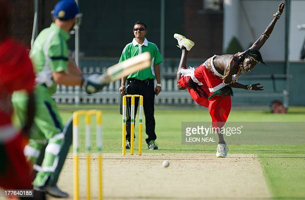 Sonyanga Mike Weblen Ng'ais of the Maasai Warrior cricket team bowls in a friendly match against the Charity VIII team during opening ceremony...