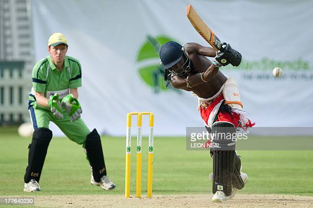 Sonyanga Mike Weblen Ng'ais of the Maasai Warrior cricket team hits a shot during a friendly match against the Charity VIII team during opening...