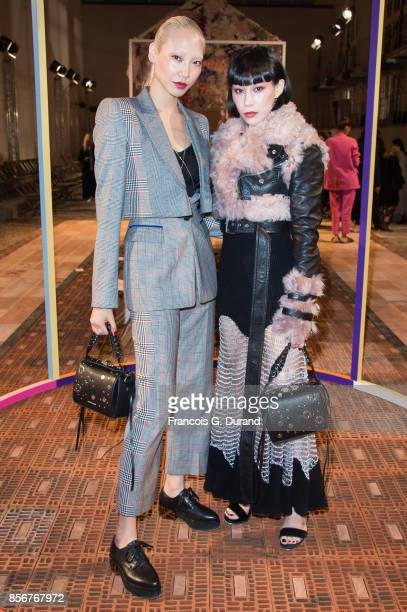 Soo Joo Park and Mademoiselle Yulia attend the Alexander McQueen show as part of the Paris Fashion Week Womenswear Spring/Summer 2018 on October 2...