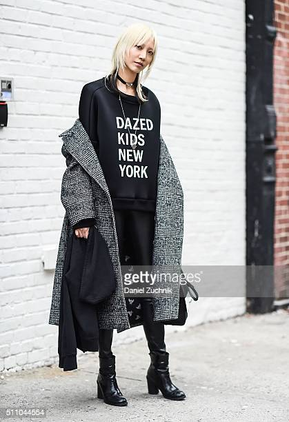 Soo Joo Park is seen outside the DKNY show wearing a DKNY sweater during New York Fashion Week Women's Fall/Winter 2016 on February 17 2016 in New...