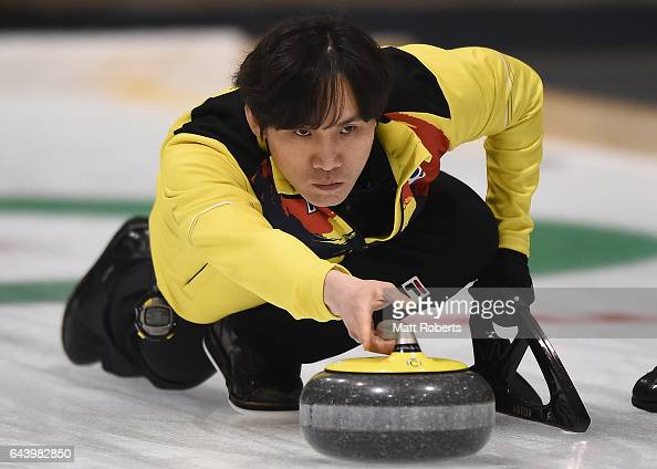 Soohyuk Kim of Korea places a stone during the men's curling bronze medal game beween Chinese Taipei and Korea on day six of the 2017 Sapporo Asian...