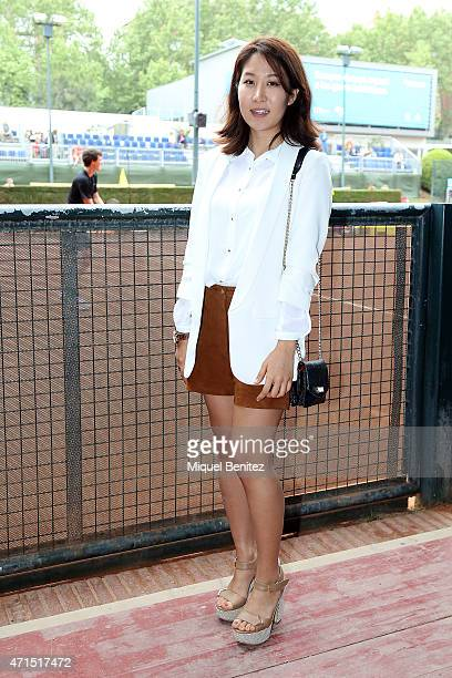 Soojin wears a Zara jacket and white shirt Mango shorts Michael Kors wristwatch L'Amour sandals and a Uterque handbag during the 63th Barcelona Open...
