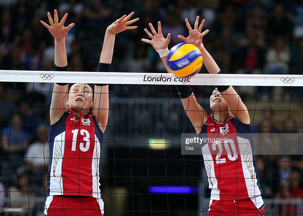 Sook-Ja Lee #20 of Korea blocks a shot as teammate Dae-Young Jung #13 helps in the fourth set against Italy during Women's Volleyball quarterfinals on Day 11 of the London 2012 Olympic Games at Earls Court on August 7, 2012 in London, England.