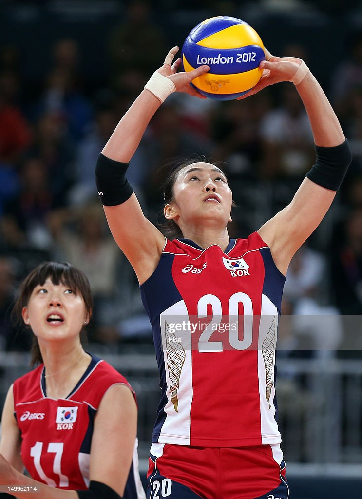 Sook-Ja Lee #20 of Korea sets the ball in the fourth set against Italy during Women's Volleyball quarterfinals on Day 11 of the London 2012 Olympic Games at Earls Court on August 7, 2012 in London, England.