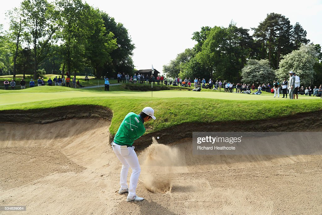 Soomin Lee of Korea hits his from a bunker on the 5th hole during day two of the BMW PGA Championship at Wentworth on May 27, 2016 in Virginia Water, England.