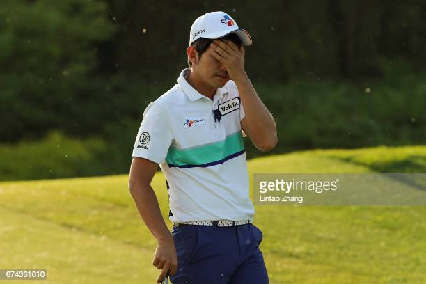 Soomin Lee of Korea reacts after plays a shot during the second round of the 2017 Volvo China open at Topwin Golf and Country Club on April 28 2017...