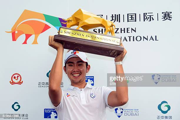 Soomin Lee of South Korea poses with the trophy after winning the Shenzhen International golf tournament at Genzon Golf Club in Shenzhen southern...
