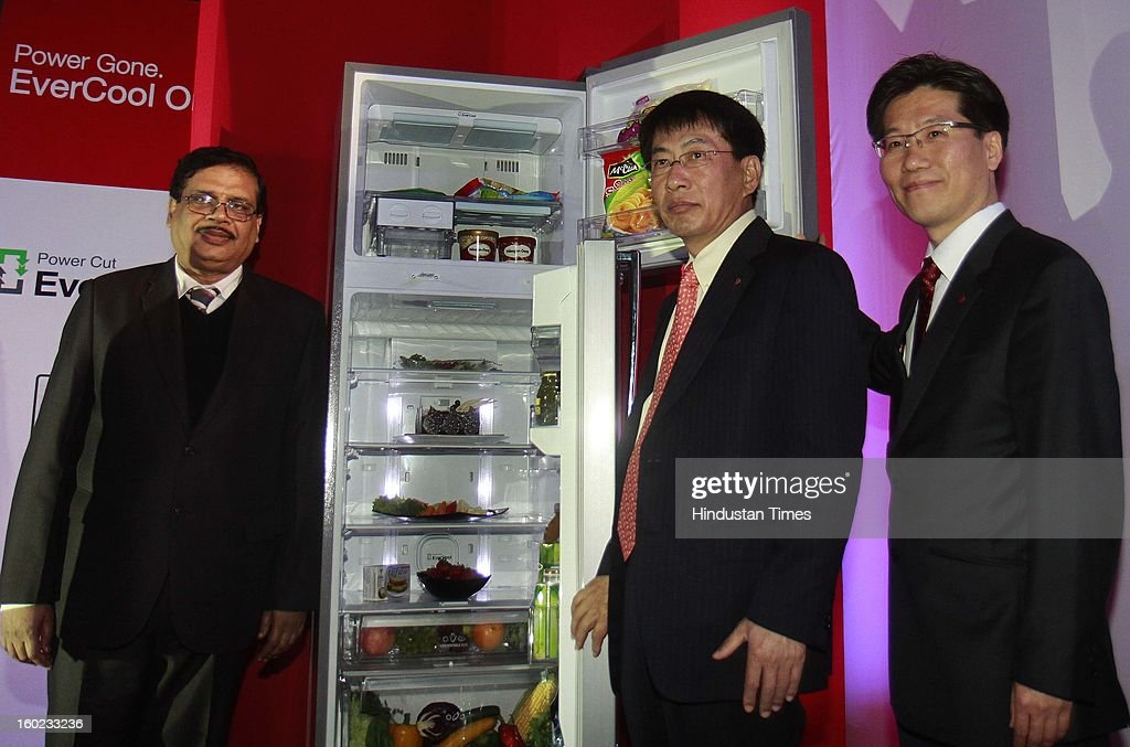 Soon Kwon (2 L) Managing Director LG Electronics India with YV Verma (L) Director- Home Appliances LGEIL launch new premium range of Power Cut EverCool refrigerators on January 28, 2013 in New Delhi, India. This patented technology has ability to retain cooling for up to seven hours and freezing for two more hours without electricity.