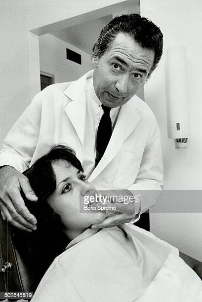 Soon no pain Dr Malcolm Yasny inserts a device like a boxer's mouthguard to treat dislocated disc in jaw of Linda Gramolini 20