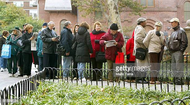 Soontobe flu vaccine recipients wait in line outside the District Health Center October 22 2004 in New York City A total of 350 doses were given to...