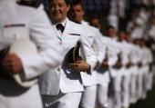 Soontobe graduates of the US Naval Academy arrive for graduation ceremonies May 23 2014 in Annapolis Maryland US Secretary of Defense Chuck Hagel...