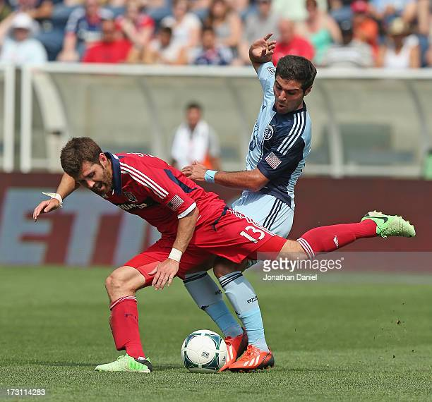 Soony Saad of Sporting Kansas City knocks down Gonzalo Segares of the Chicago Fire during an MLS match at Toyota Park on July 7 2013 in Bridgeview...