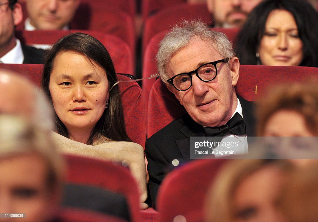 Soon-Yi Previn (L) and Woody Allen sit in the audience at the Opening Ceremony at the Palais des Festivals during the 64th Cannes Film Festival on May 11, 2011 in Cannes, France.