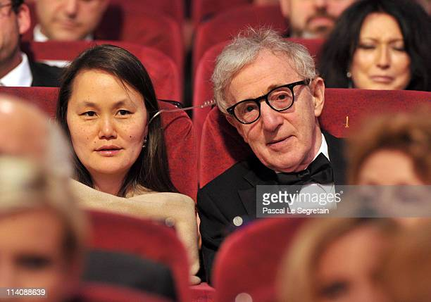 SoonYi Previn and Woody Allen sit in the audience at the Opening Ceremony at the Palais des Festivals during the 64th Cannes Film Festival on May 11...
