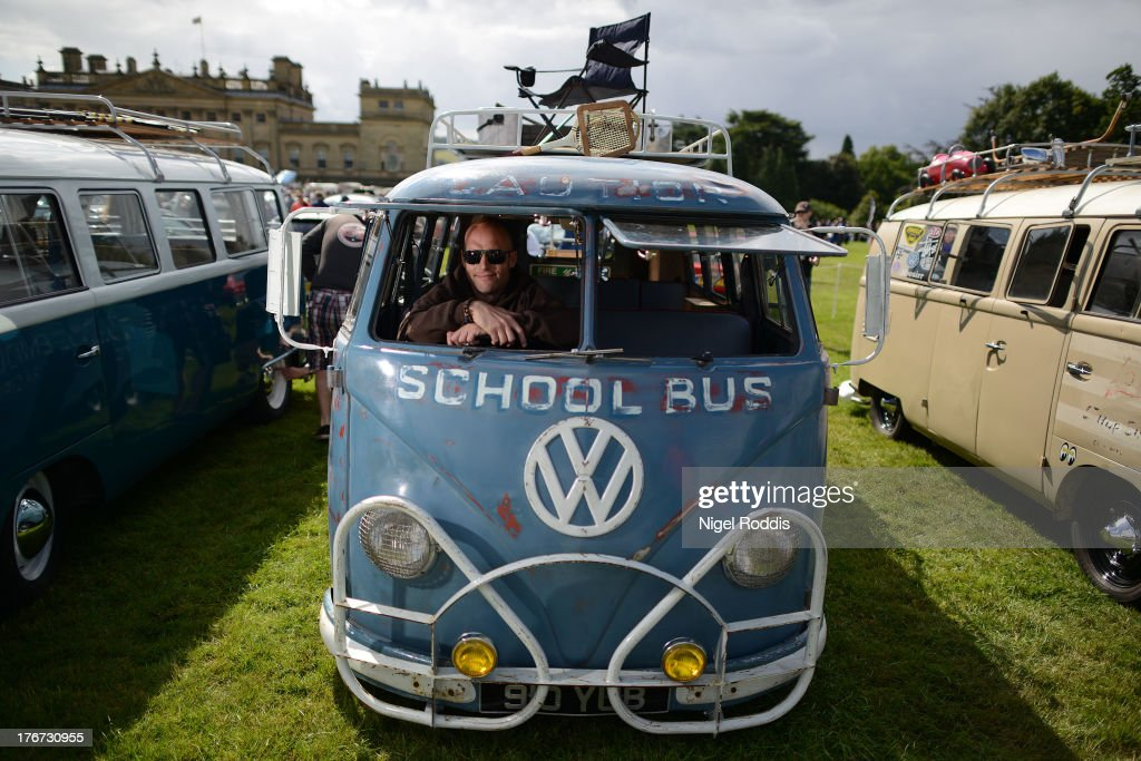 Sooty Shuttleworth of Bingley sits in his 1957 VW splitscreen, a former Queenwood school bus in Australia on display during the 'In Praise Of All Things VW At The Annual Festival' at Harewood House on August 18, 2013 in Leeds, England. The annual VW festival is in its 9th year attracting around 15,000 people over the weekend, ending with the winners car parade on Sunday.
