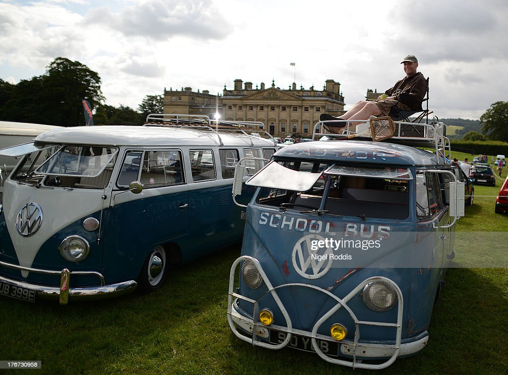 Sooty Shuttleworth of Bingley sits on his 1957 VW splitscreen, a former Queenwood school bus in Australia on display during the 'In Praise Of All Things VW At The Annual Festival' at Harewood House on August 18, 2013 in Leeds, England. The annual VW festival is in its 9th year attracting around 15,000 people over the weekend, ending with the winners car parade on Sunday.
