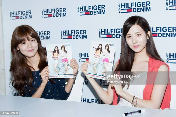 Sooyoung and Seohyun of South Korean girl group Girls' Generation attend an autograph session for the 'Tommy Hilfiger Denim' at Hyundai Department...