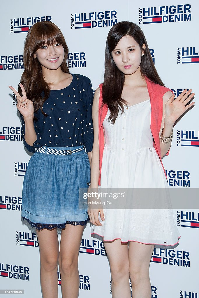 Sooyoung and Seohyun of South Korean girl group Girls' Generation attend an autograph session for the 'Tommy Hilfiger Denim' at Hyundai Department Store on July 28, 2013 in Seoul, South Korea.