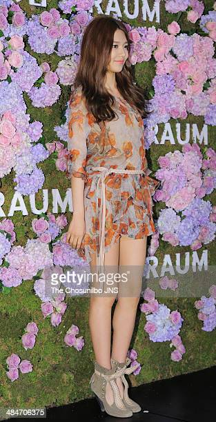 SooYoung of Girls' Generation poses for photographs during the Raum flagship store renewal opening housewarming party on April 10 2014 in Seoul South...