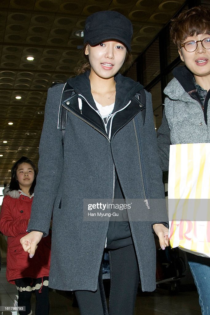 Sooyoung of South Korean girl group Girls' Generation is seen at Gimpo International Airport on February 15, 2013 in Seoul, South Korea.