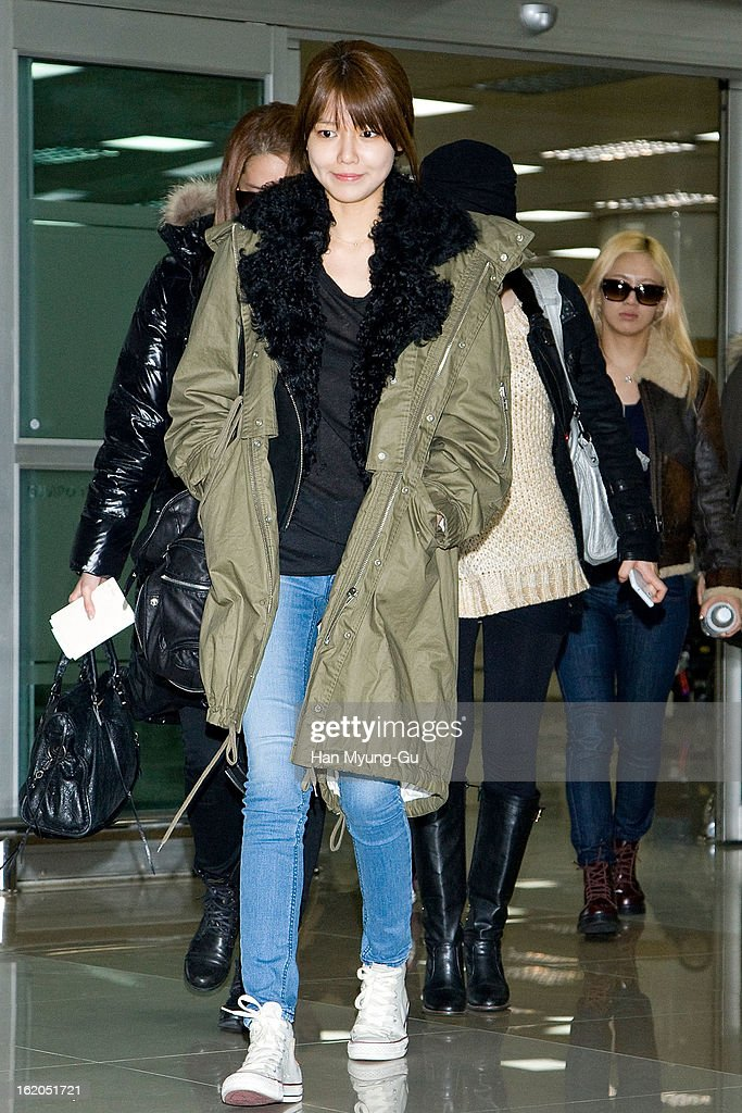 Sooyoung of South Korean girl group Girls' Generation is seen upon arrival at Gimpo International Airport on February 18, 2013 in Seoul, South Korea.