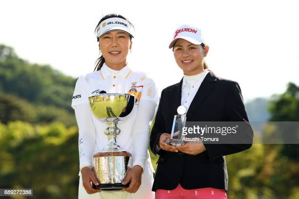 SooYun Kang of South Korea and Hina Arakaki of Japan pose with the trophy during the final round of the Resorttrust Ladies at the Oakmont Golf Club...