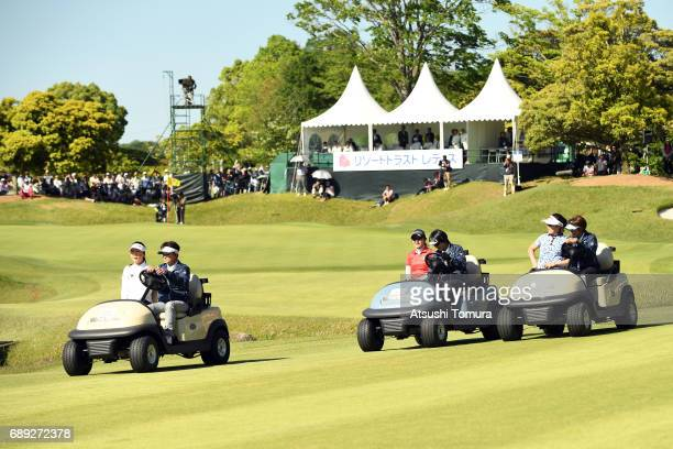 SooYun Kang of South Korea MiJeong Jeon of South Korea and Saiki Fujita of Japan sit in golf cart as they are driven to the 18th tee for a playoff...
