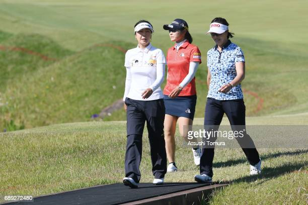 SooYun Kang of South Korea Saiki Fujita of Japan and MiJeong Jeon of South Korea walk to the golf cart for a playoff during the final round of the...