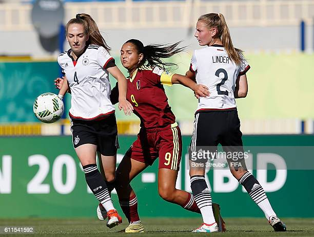 EPTEMBER 30 Sophia Kleinherne and Sarai Linder of Germany challenge Deyna Castellanos of Venezuela during the FIFA U17 Women's World Cup Group B...