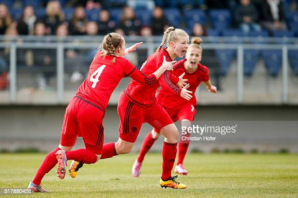 Sophia Kleinherne AnnaLena Stolze and Giulia Gwinn of Germany celebrate after scoring during the U17 Girl's Euro Qualifier match between Austria and...
