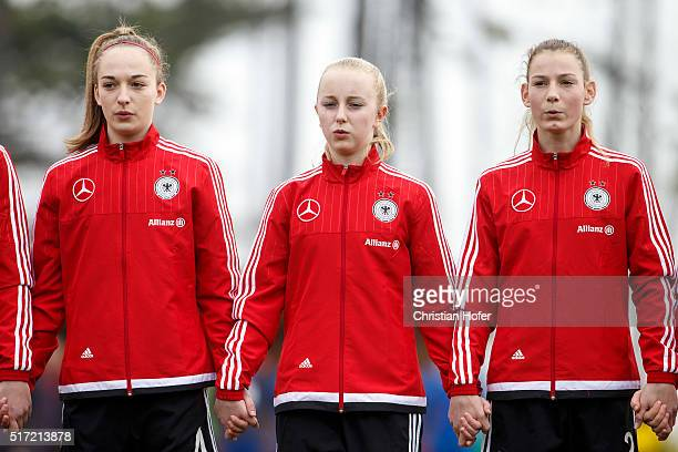 Sophia Kleinherne Caroline Siems and Sarai Linder of Germany line up during the national anthem prior to the U17 Girl's Euro Qualifier match between...