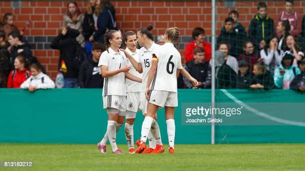 Sophia Kleinherne Dina Orschmann Tanja Pawollek and Janina Minge of Germany celebrate after the international friendly match between U19 Women's...