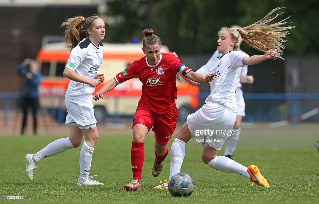 Sophia Kleinherne Katja Friedl and Valentina Vogt battle for the ball during the U17 Girl's Bundesliga semi final first leg match between Turbine...