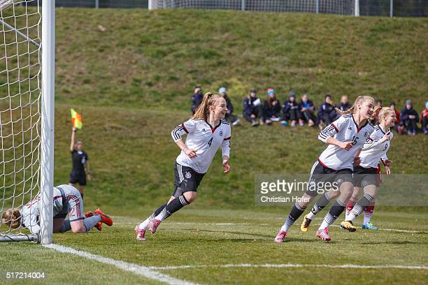Sophia Kleinherne Marie Mueller and AnnaLena Stolze of Germany celebrate after scoring during the U17 Girl's Euro Qualifier match between Germany and...