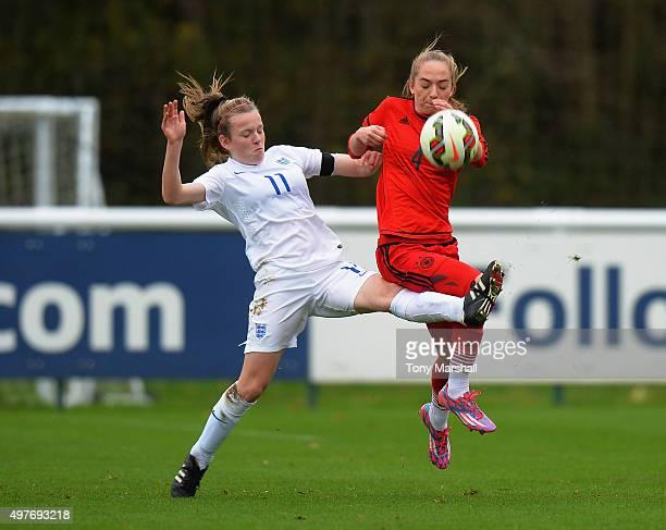 Sophia Kleinherne of Germany is tackled by Lauren Hemp of England during Women's U16s International Friendly match between England U16s Women and...